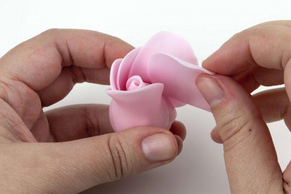 Tucking Petals Inside The Rose