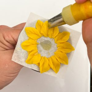Pipe royal icing flowers