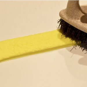 Mix yellow Pro gel colour with 20g sugarpaste. Roll out a 30cm strip and texturize to give a fleece effect with a scrubbing brush. Cut to size and line the inside edge of the boot and tongue.