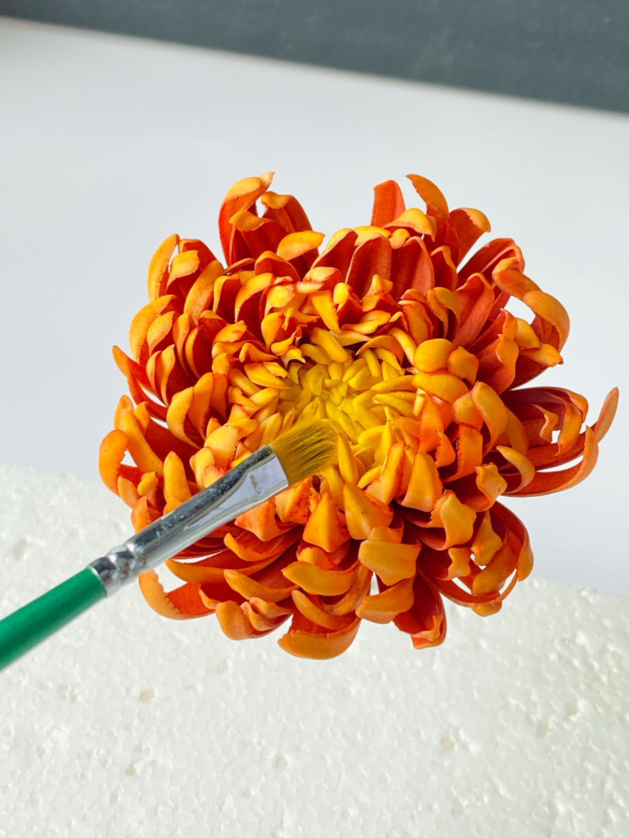 Carefully cut and paint sugarpaste flower petals