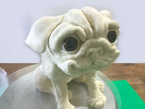 Shape sugarpaste for a realistic animal