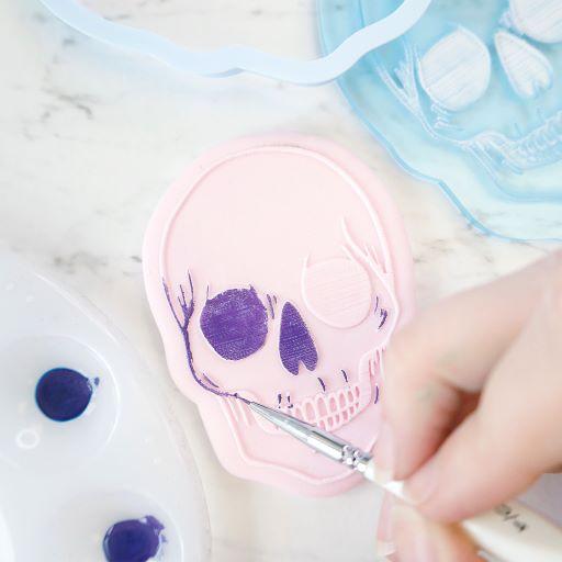Paint detailed sugarpaste designs